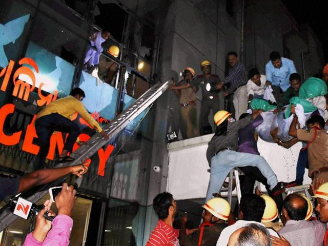 Patients being shifted from SUM Hospital where a fire broke in Bhubaneswar.