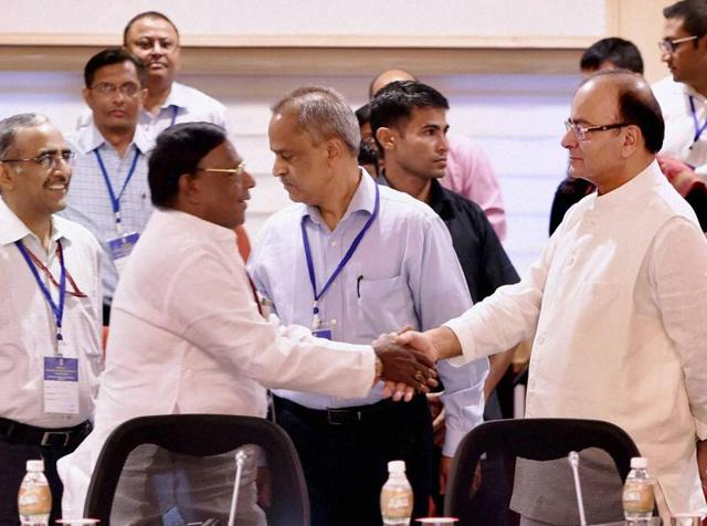 Union finance minister Arun Jaitley and Puducherry chief minister V Narayanasamy shake hands at the meeting of the GST Council at Vigyan Bhawan in New Delhi on Tuesday.