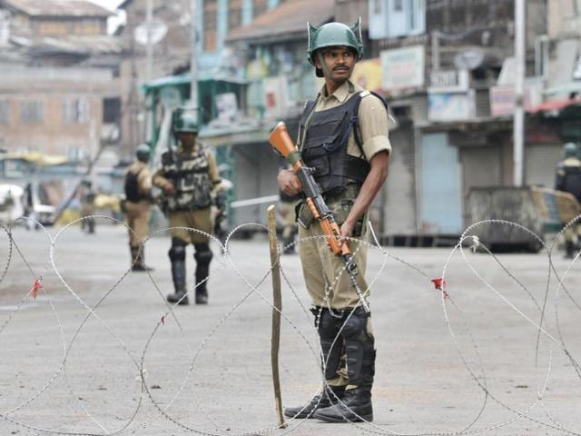 Paramilitary soldiers stand guard during a curfew in Srinagar.