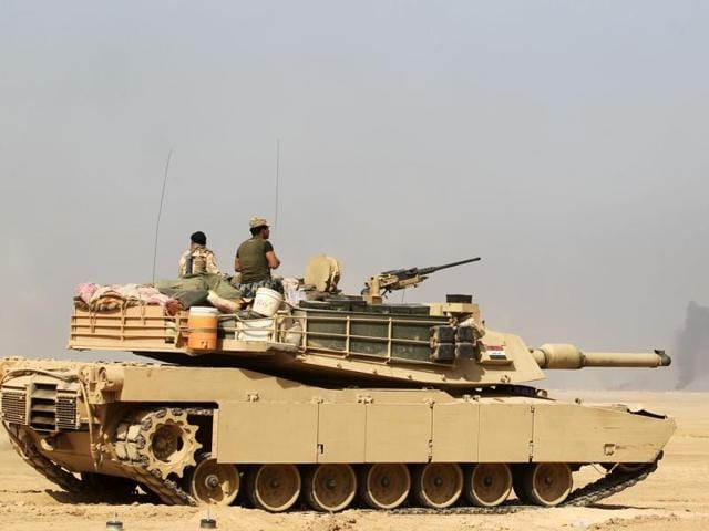 Iraqi forces deployin the area of al-Shurah, some 45 kms south of Mosul, as they advance towards the city to retake it from the Islamic State (IS) group jihadists.