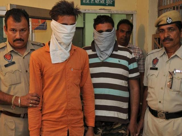 The accused in police custody in Jalandhar on Tuesday.