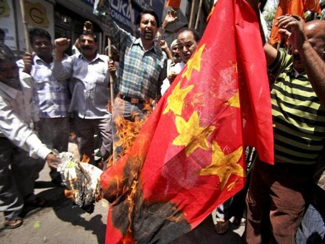 Chinese flags along with incriminating material were recovered during raids at suspected hideouts of militants in Kashmir's Baramulla.