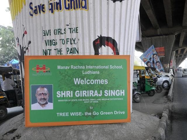 A hoarding put up in front of the graffiti on station road in Ludhiana on Monday.