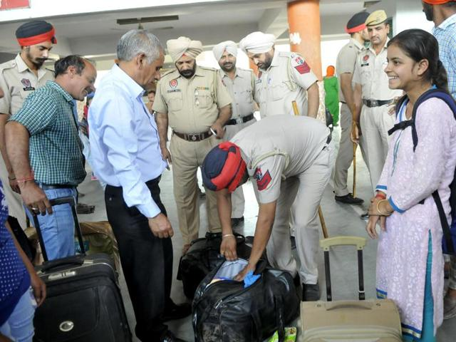 Police checking luggage and vehicles at the ISBT in Ludhiana on Monday.