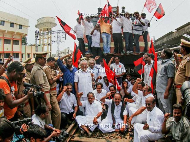 MDMK chief Vaiko, CPM leader G Ramakrishnan and others stage a rail roko at the Central Railway station demanding the constitution of a Cauvery management board, in Chennai on Monday.