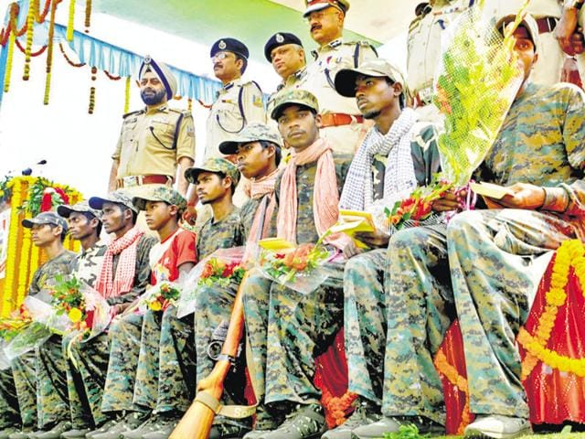 Nine PLFI members at the police headquarters in Ranchi after their surrender on Monday.