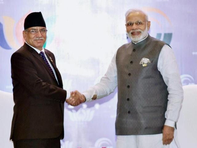 Prime Ministers Narendra Modi (left) and Nepal's Pushpa Kamal Dahal 'Prachanda' (centre) with Chinese president Xi Jinping (right) in Goa on October 15, 2016.