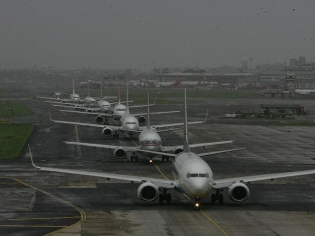 Aeroplanes lined up for take off at Mumbai domestic airport.