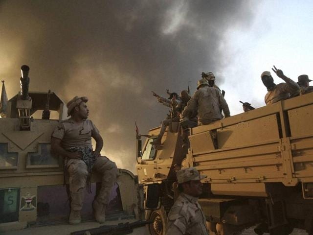Iraqi forces deployed during an offensive to retake Mosul from Islamic State militants outside Mosul, Iraq, on Tuesday.