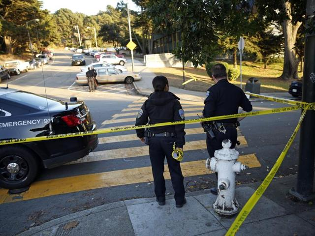 San Francisco Police stand at the site of a shooting outside the June Jordan School for Equity and City Arts and Technology High School, which share a campus, in San Francisco, California.