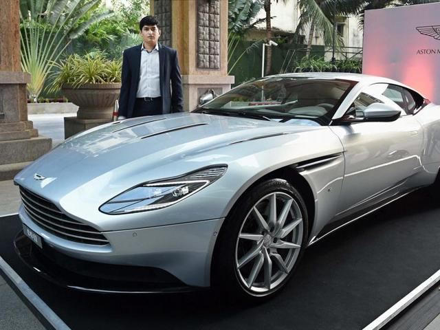 Aston Martin marketing manager Gaurav Parikh poses with new car DB11 at its launch in Chennai on Wednesday.