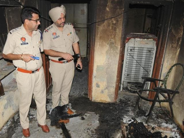 Police inspecting the house where the mother-son duo committed suicide in Patiala.