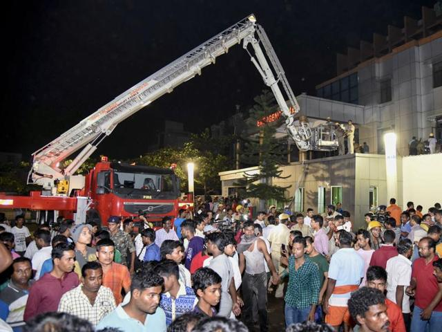 This photograph taken on October 17, shows Indian rescue workers trying help victims of a massive fire at the SUM hospital building in Bhubaneswar