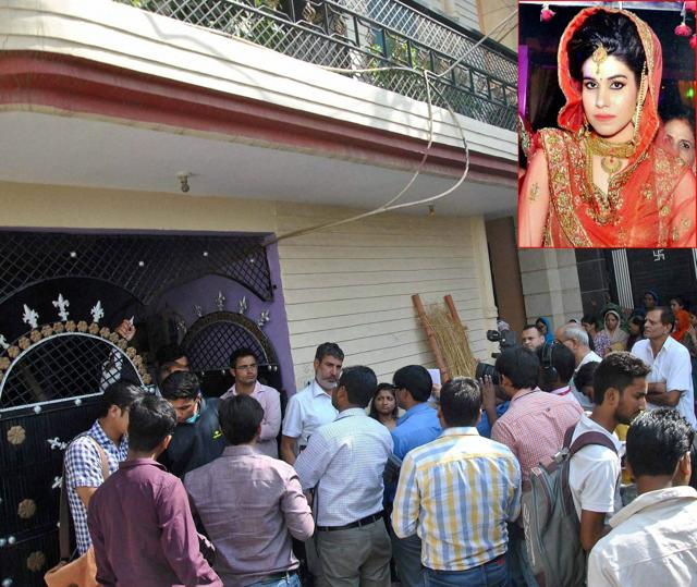 People gather after Lalita (inset), wife of national level kabaddi player Rohit Kumar was found hanging at her home in Nangloi, New Delhi on October 17, 2016.