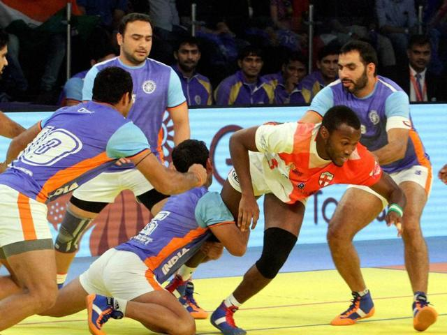 "Indian Kabaddi team players try to catch an England player during ""Kabaddi World Cup"" match in Ahmedabad on Tuesday, Oct 18, 2016. India defeated England to enter the semis."