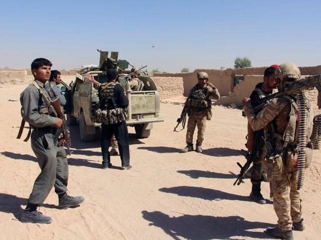 Afghan special forces and policemen prepare themselves for battle with the Taliban on the outskirts of Lashkar Gah capital of Helmand, Afghanistan.