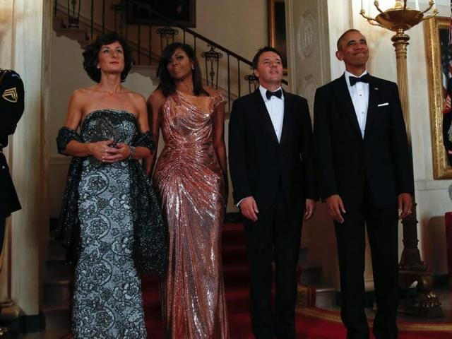 US President Barack Obama (right) with US First Lady Michelle Obama (second left) welcome Italian Prime Minister Matteo Renzi (second right) and his wife Agnese Landini (left) for the State Dinner at the White House in Washington on Tuesday.