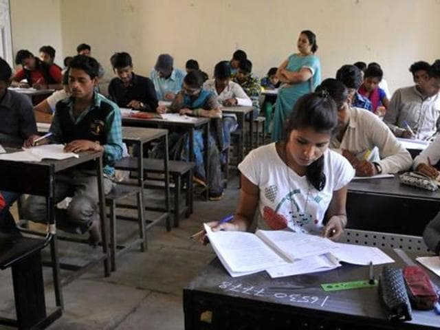 Students appear for the Class 10 board exam in Indore, on March 2, 2016.