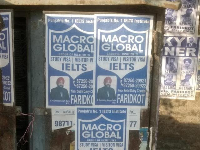 Posters pasted on a power metre box in Faridkot.