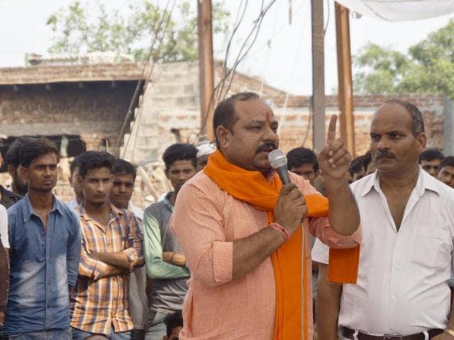 (Left to Right) BJP MLA Sangeet Som addressing the crowd at Bisada with DM NP Singh, Union minister and Gautam Buddha Nagar MP Mahesh Sharma and SSP Dharmendra Singh.