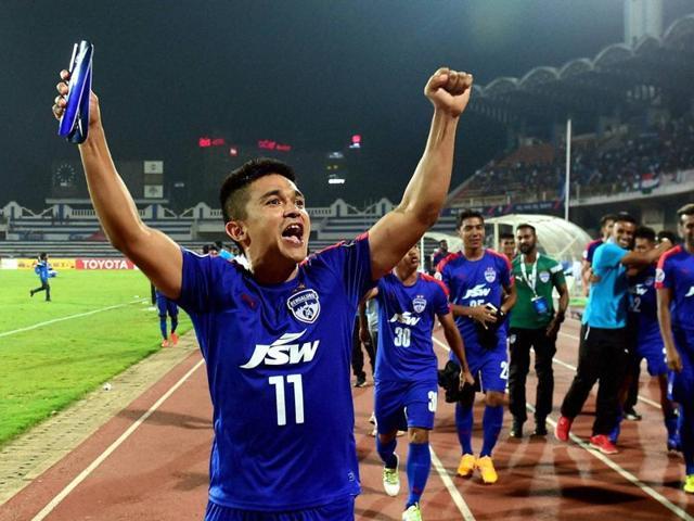 Bengaluru FC's players celebrate their win.