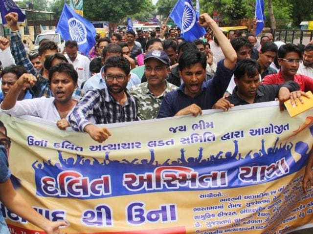 Protestors  shout slogans during a march from Ahmedabad to Una town where four Dalits were brutally beaten by alleged vigilantes for skinning a dead cow, in Ahmedabad in Gujarat,  on Friday, Aug. 5, 2016.