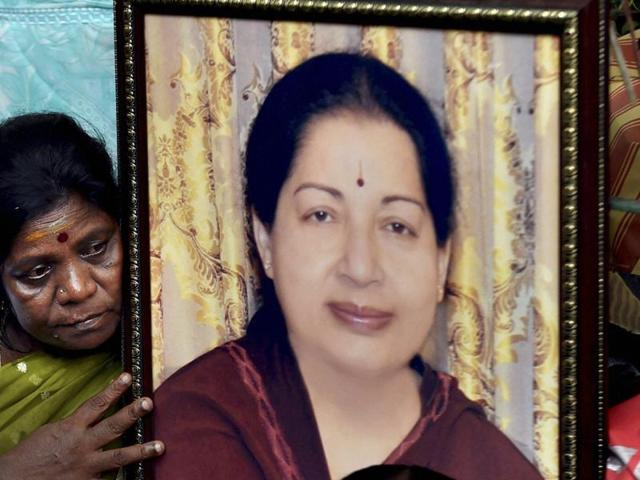 An AIADMK women's wing member with the portrait of Tamil Nadu chief minister J Jayalalithaa.