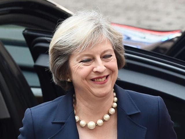 Britain's Prime minister Theresa May arrives for an European Union leaders summit on Thursday at the European Council, in Brussels.