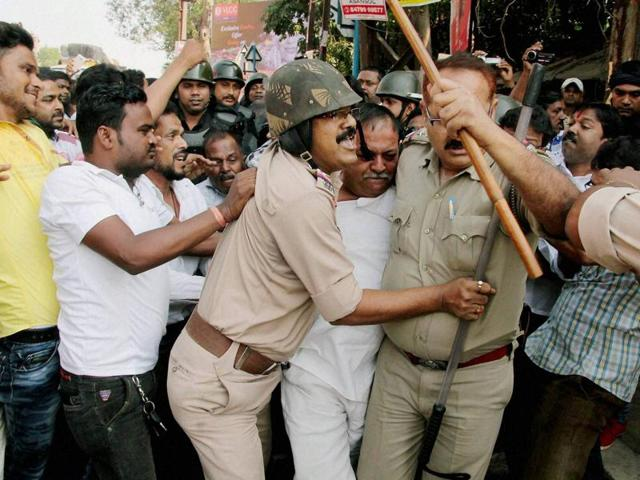 Police arrest miscreants during a clash between BJP and TMC workers in Asansol, West Bengal