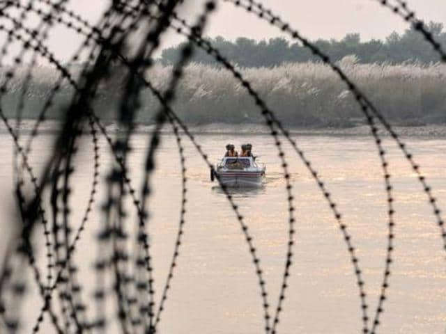 BSF forces patrol the Indus River near the international border with Pakistan.
