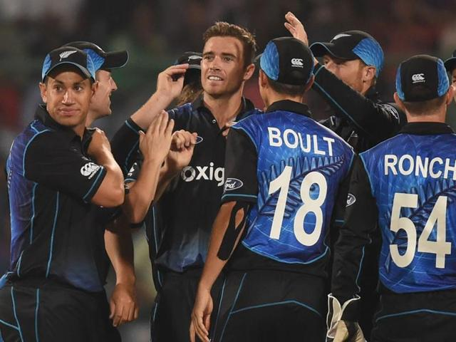 New Zealand's Tim Southee (C) celebrates the wicket of India's captain Mahendra Singh Dhoni with teammates.