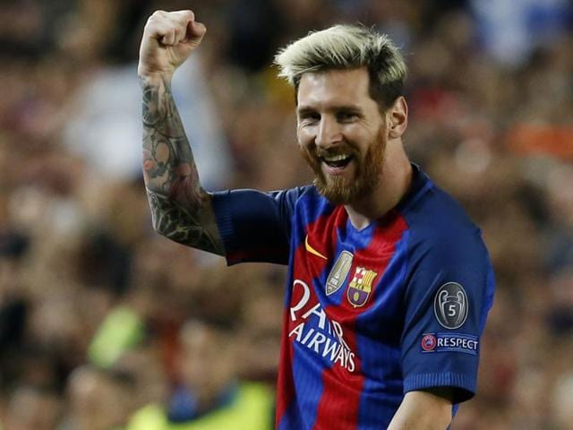 Messi applauds the fans at the end of the match.