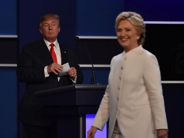 Republican nominee Donald Trump (L) speaks as Democratic nominee Hillary Clinton looks on during the final presidential debate in Las Vegas, Nevada
