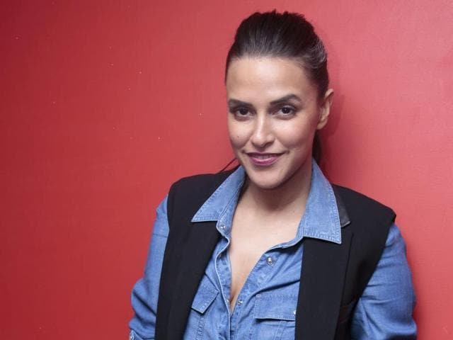 Actor Neha Dhupia says her work does not give her tough times.