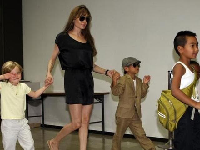 Angelina Jolie (2nd L) arrives with her children Shiloh (L), Pax Thien, Maddox (front R) and Zahara (back R) at New Tokyo International Airport in Narita, east of Tokyo, Japan on July 26, 2010.