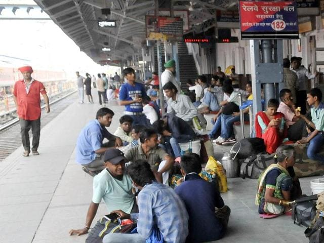 Passengers waiting for the trains at Ludhiana railway station on Wednesday.