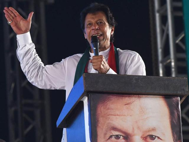 Pakistan's cricketer turn politician Imran Khan (centre) waves to his supporters at an anti-government rally in Lahore, Pakistan on September 30.