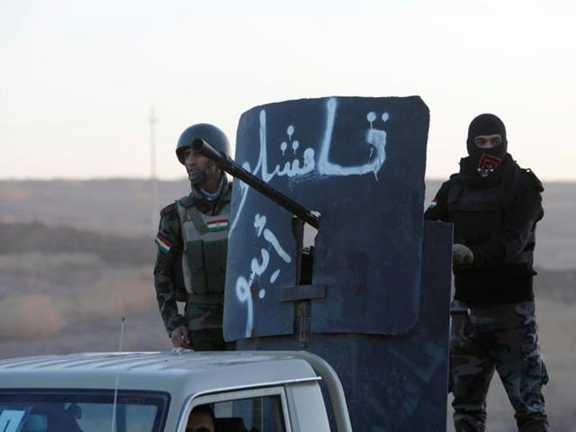 Peshmerga forces advance in the east of Mosul to attack Islamic State militants in Mosul.