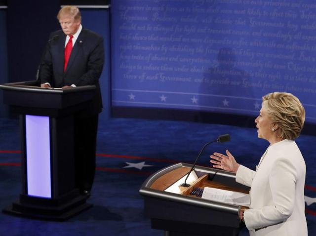 Republican US presidential nominee Donald Trump listens to Democratic nominee Hillary Clinton speaks during their third and final 2016 presidential campaign debate at UNLV in Las Vegas, Nevada.
