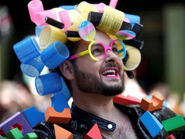 A participant takes part in the annual Pride London Parade which highlights issues of the gay, lesbian and transgender community on June 25, 2016.