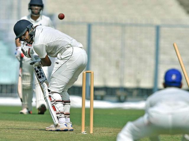 Delhi batsman N Rana is clean bowled by Karnataka bowler A.Mithun.