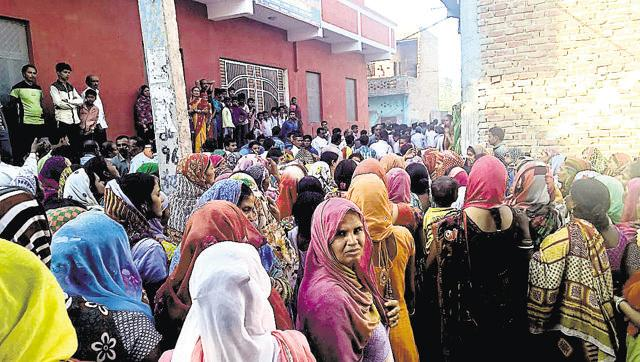Crowds gather for Aasharam's last rites.