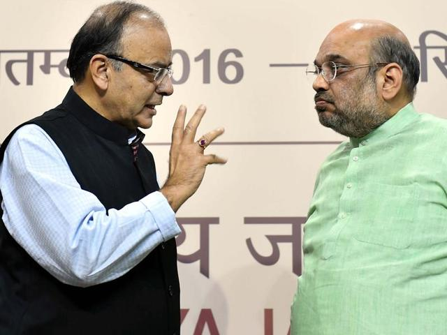 BJP president Amit Shah, right, with finance minister Arun Jaitley at the release of the latter's book at the party headquarters in New Delhi on Thursday.