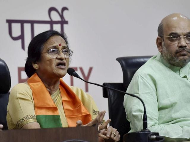 BJP president Amit Shah looks on as former UP Congress president Rita Bahuguna Joshi speaks to media after joining the Bharatiya Janata Party at party headquarters in New Delhi.