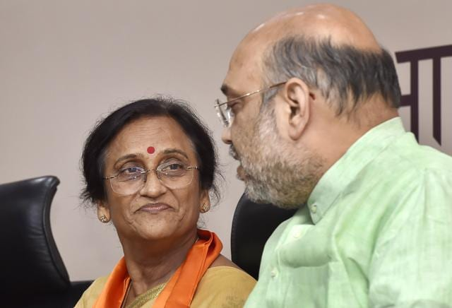 Rita Bahuguna Joshi, former Uttar Pradesh Congress chief with BJP President Amit Shah while she joins the BJP Party at BJP HQ in New Delhi.
