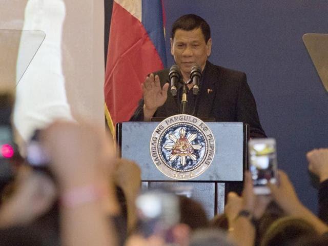 Philippine President Rodrigo Duterte addresses members of the Philippine community in Beijing, China, Wednesday, Oct. 19, 2016.