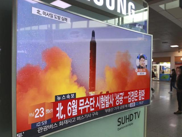 A TV screen shows a file image of a missile launch conducted by North Korea in a local news program, at Seoul Railway Station in Seoul, South Korea, Sunday, Oct. 16, 2016.