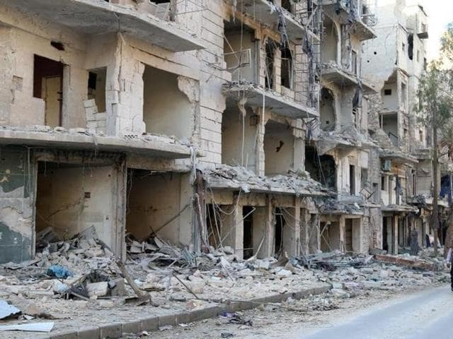 A man walks past damaged buildings in the rebel held besieged al-Sukkari neighbourhood of Aleppo, Syria on October 19.