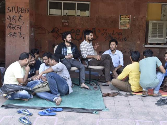 Students protest outside the admin block at JNU in New Delhi on Thursday.