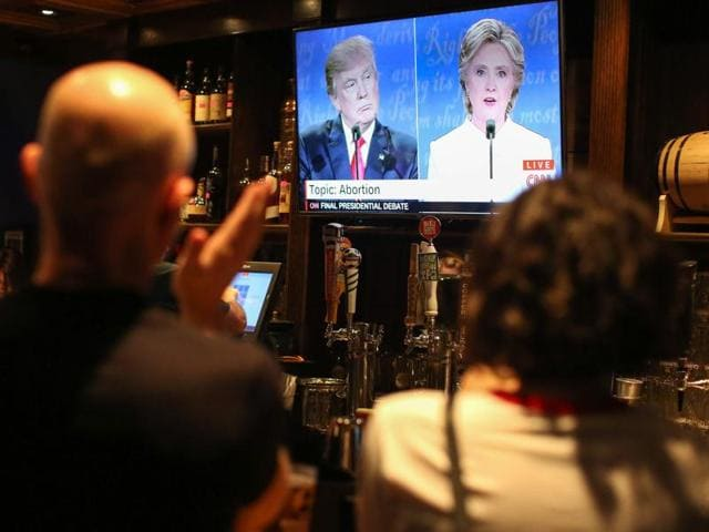 People watch the third US presidential debate between Democratic candidate Hillary Clinton and Republican  candidate Donald Trump at Murphy's Tap House in uptown Charlotte, North Carolina.